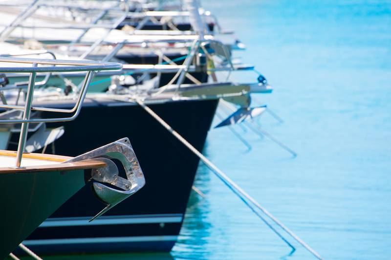 Boat bow with Anchor detail of sailboats in a row